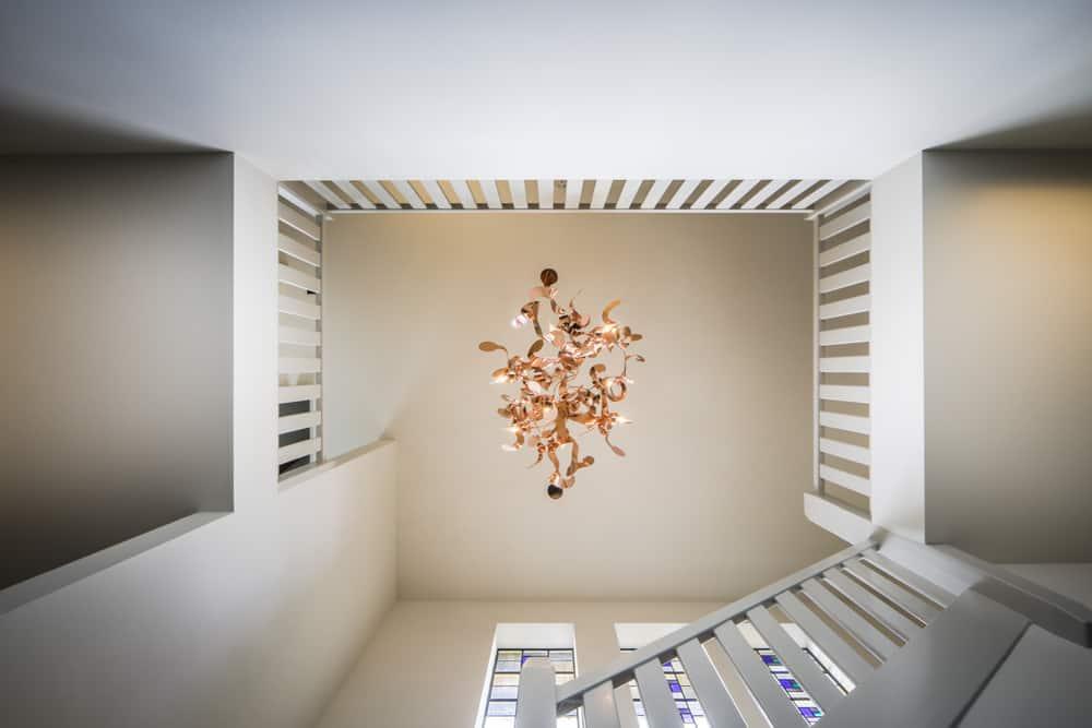 interieurarchitect ontwerpt renovatie originele details lichtarmatuur Moooi