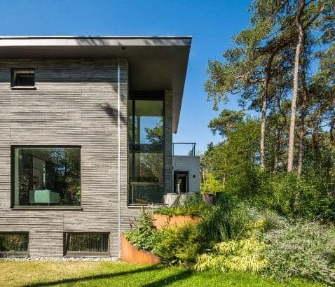 Stan van den Wildenberg ontwerpt bos villa zij aanzicht