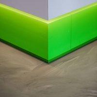 interieur architect Stan van den Wildenberg ontwerpt entree met belttering kantoor Dimension Data Nederland in Amersfoort met gietvloer