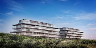 interieurarchitect Stan van den Wildenberg ontwerpt appartement in Blanke Top van Groep Versluys in Cadzand frontaal aanzicht van architect Govaert & Vanhoutte BRON imagicasa.be