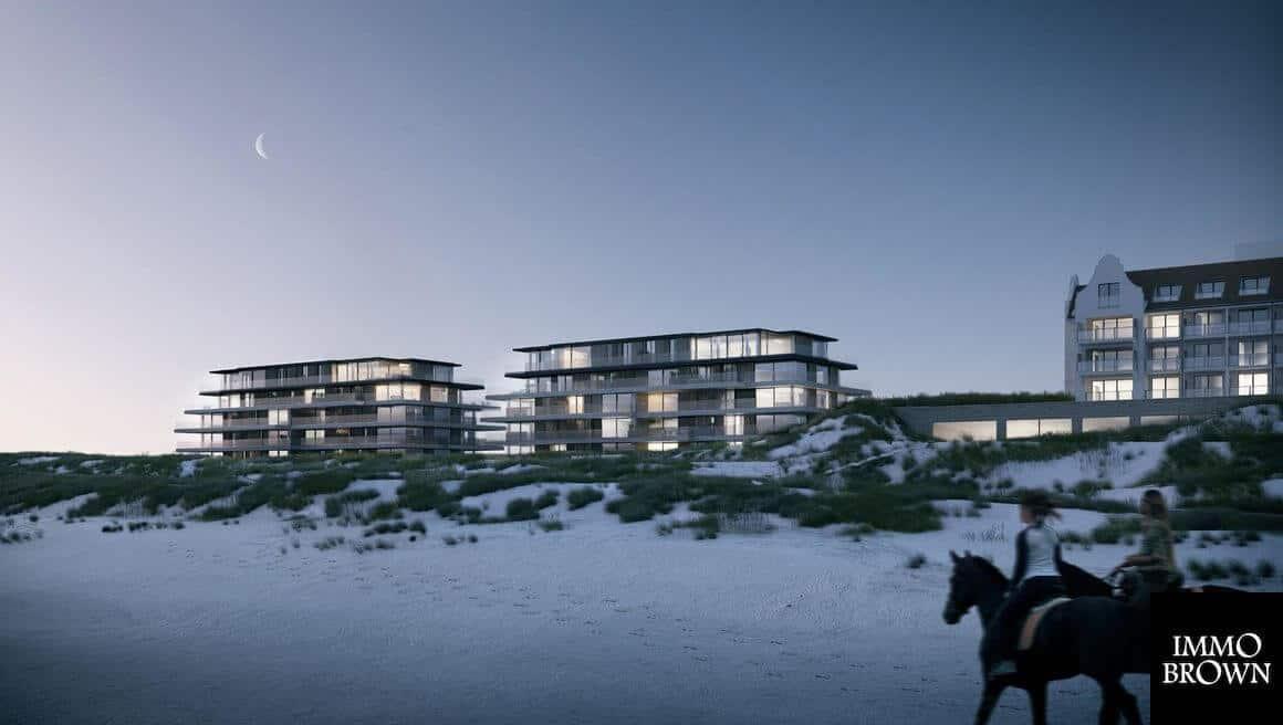 https://www.vandenwildenberg.nl/wp-content/uploads/2019/01/interieurarchitect-Stan-van-den-Wildenberg-ontwerpt-appartement-in-22Blanke-Top22-van-Groep-Versluys-in-Cadzand-zij-aanzicht-bij-avond-van-architect-Govaert-Vanhoutte-BRON-immo-brown-.jpg