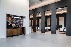 interieurarchitect Stan van den Wildenberg ontwerpt pentry met Starbucks koffiecorner en vloer Concreet van Desso voor Dimension Data Nederland in Amersfoort